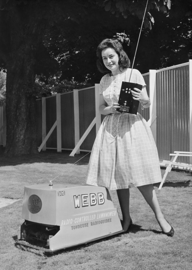Photo of woman with the H.C. Webb & Co. radio-controlled electric lawn mower.