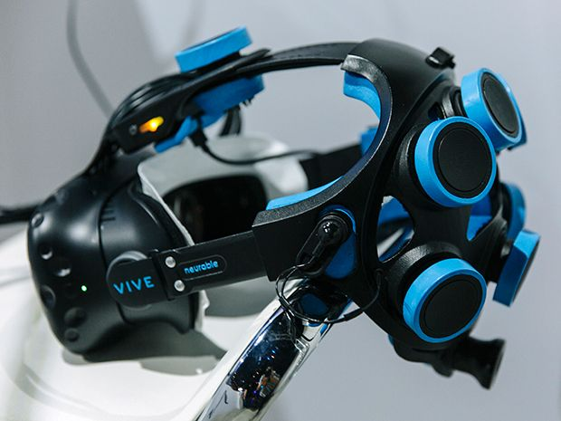 A HTC Vive virtual reality headset with Neurable's strap attached to allow for mind-controlled gaming.