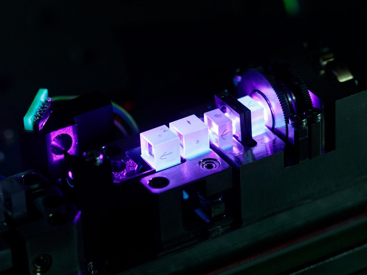 Quantum key distribution creates encryption keys using signals sent at the single-photon level. This device uses lasers and crystals to create the type of signals required for entanglement-based QKD.
