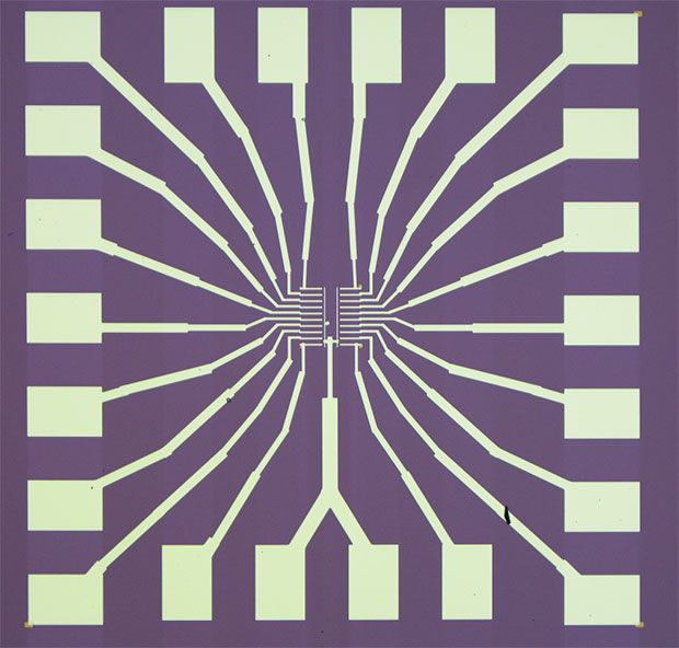 An optical microscope image of a chip with 20 devices fabricated with our nanoporous graphene.