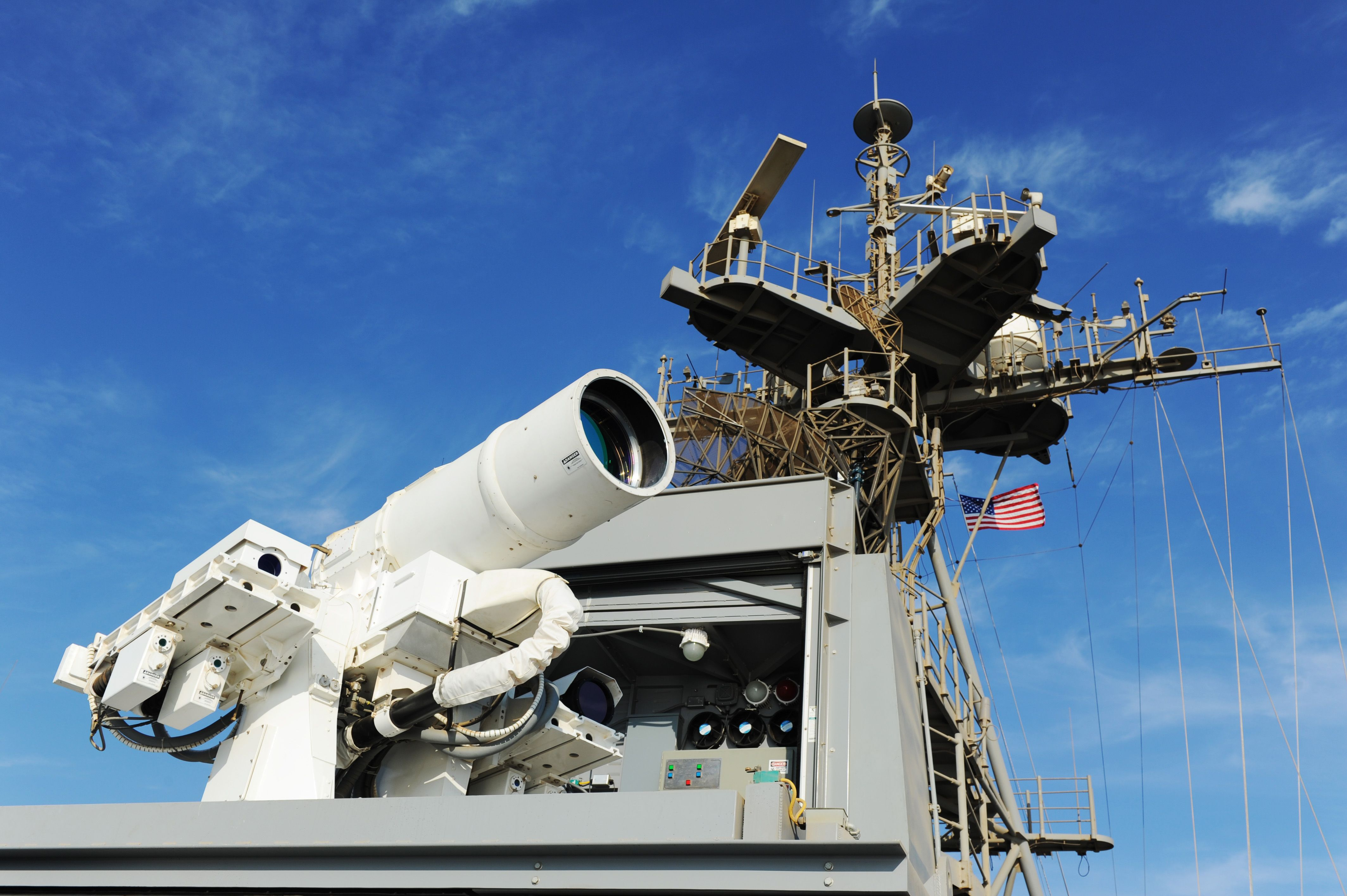 A photo shows a laser weapon (which looks like a thick telescope) mounted to the USS Ponce.