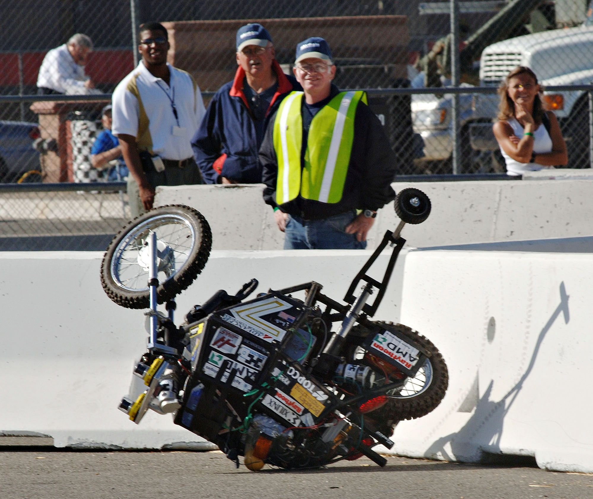 The Blue Team's Ghostrider, the world's first autonomous motorcycle, flips over after crashing into a wall during a test run for the National Qualification Event of the Defense Advanced Research Projects Agency DARPA) Grand Challenge, Tuesday, Oct. 4, 2005