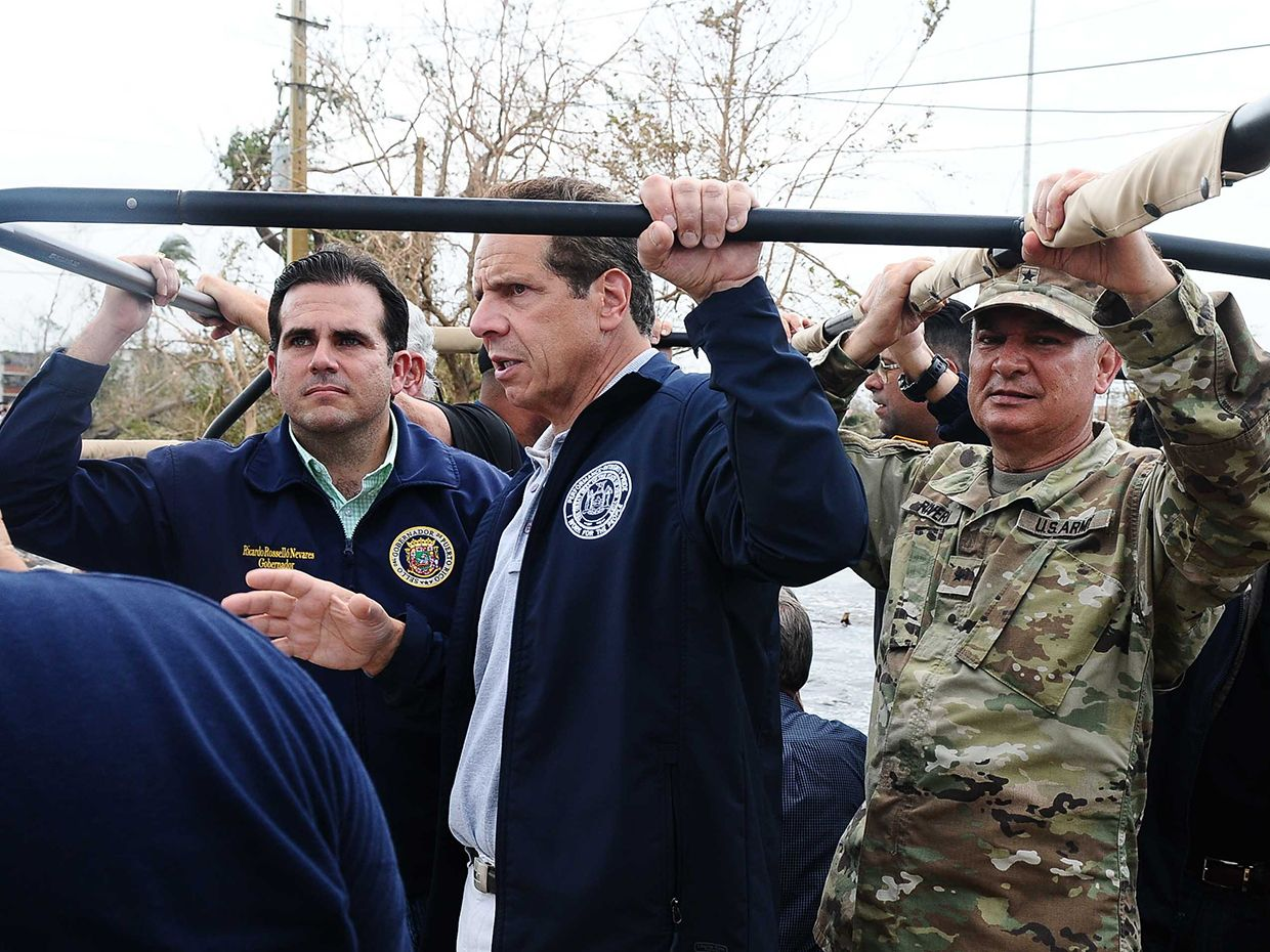 Puerto Rico Governor Ricardo Rossello Nevares, New York Gov. Andrew Cuomo, and Puerto Rico Adjutant General Brig. Gen. Isabelo Rivera, the Puerto Rico National Guard commander, visit flooded communities in Puerto Rico, Sept. 22, 2017.
