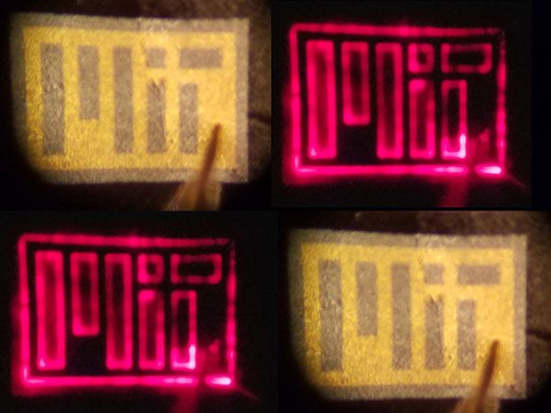 "Four images of a small flexible sheet that reads ""MIT"" in blocky letters. Two of the images glow red."