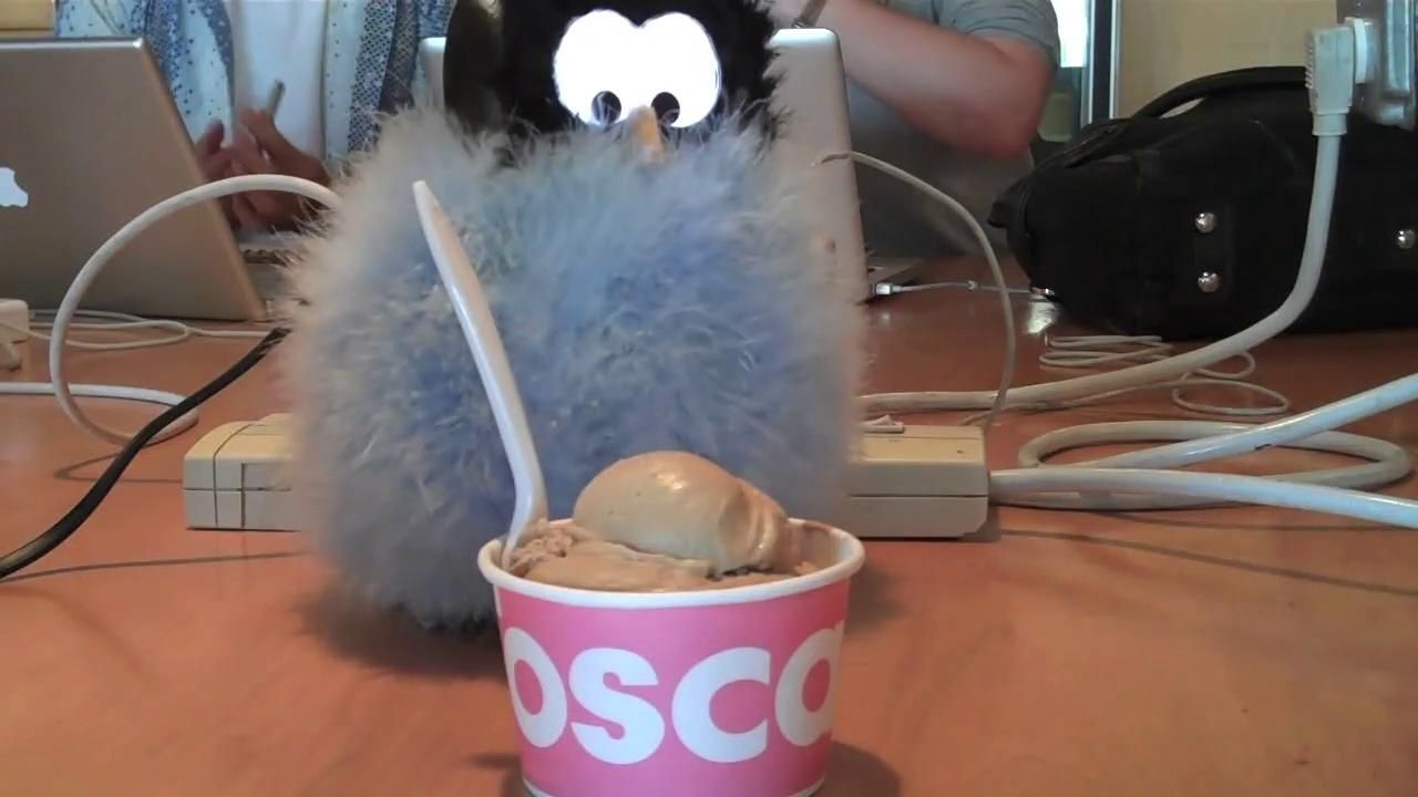 MIT Media Lab's Miso robot with a bowl of ice cream