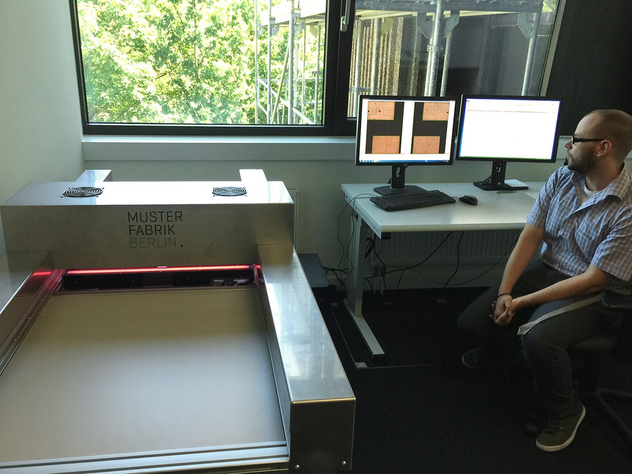 photo of a researcher at work in the scanning room
