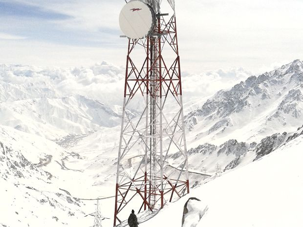 The cell tower installed at Salang Pass by Afghan Wireless is shown in snowy conditions.
