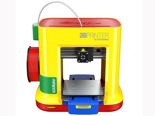 A rectangular table-top machine, brightly colored yellow, red, green, and blue.