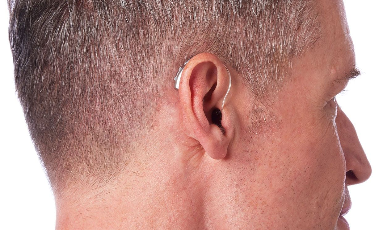 Livio AI hearing aid on a man.