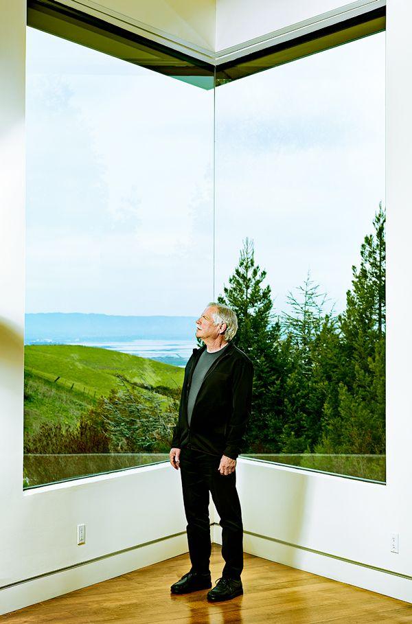Kurt Petersen standing at a window.