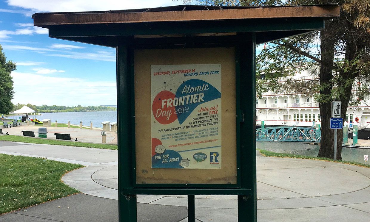 A poster advertises Atomic Frontier Day celebrations at Howard Amon Park in Richland, Wash.