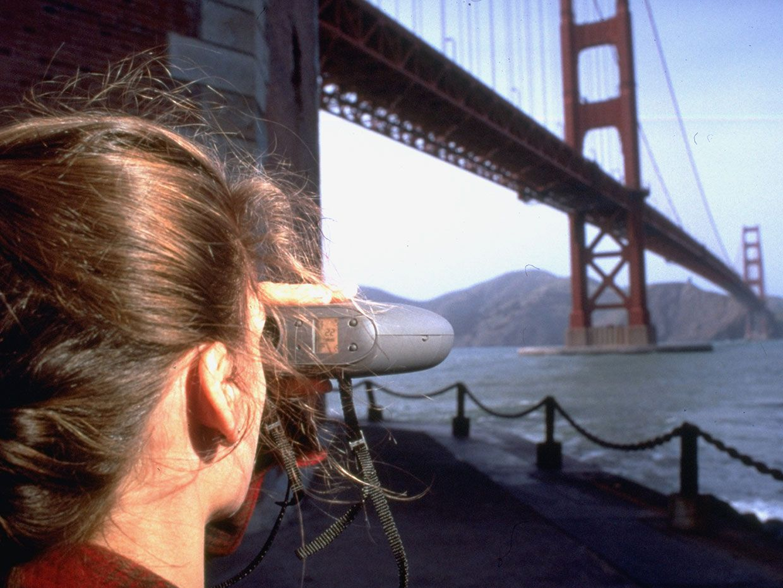 Woman using Quicktake camera.