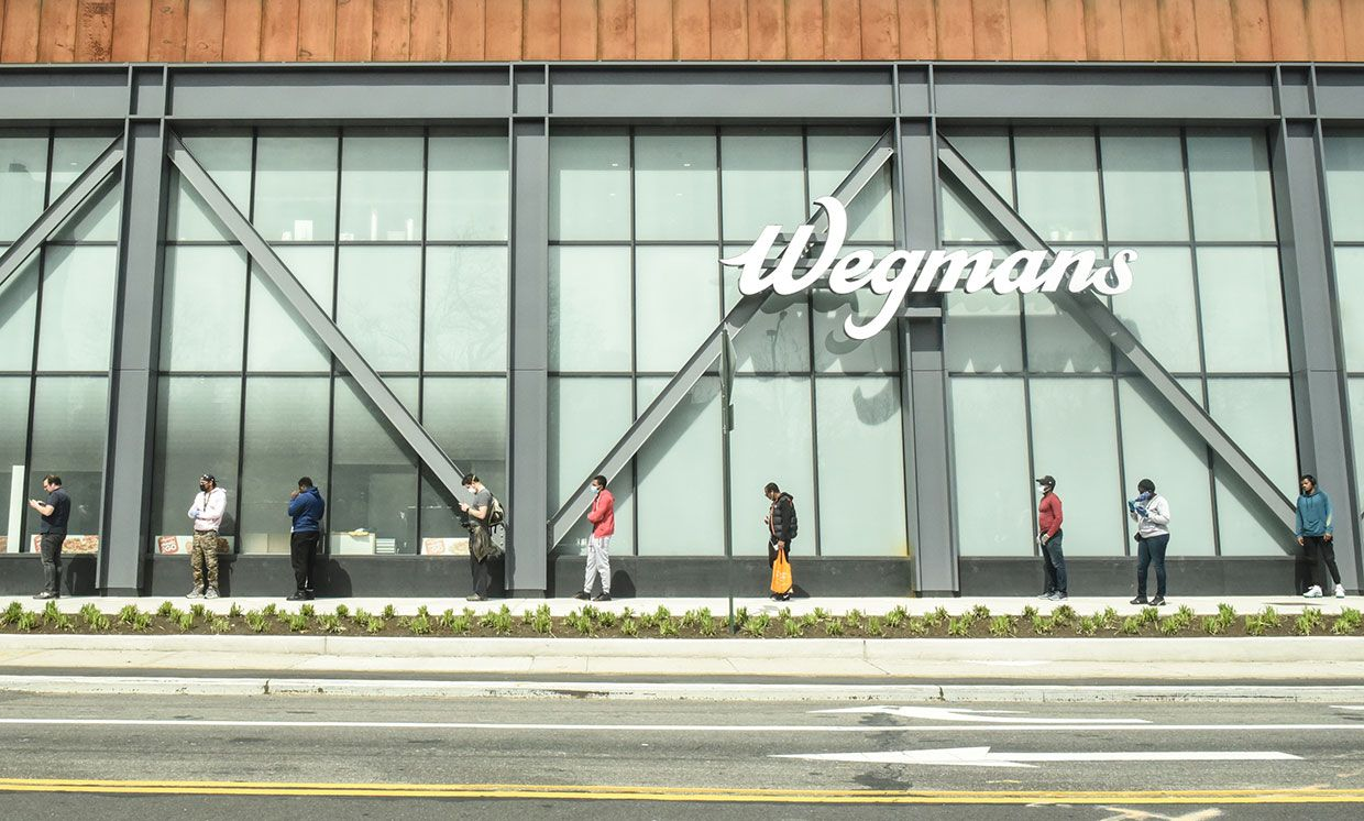 Shoppers wait their turn to buy groceries at a Wegmans supermarket in Brooklyn, N.Y., on 7 April.