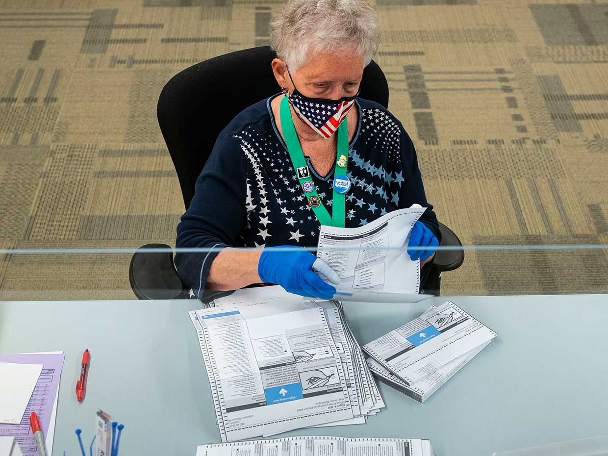 Elections worker Jan Reese opens ballots at the King County Elections headquarters on August 4, 2020 in Renton, Washington. Today is election day for the primary in Washington state, where voting is done almost exclusively by mail.