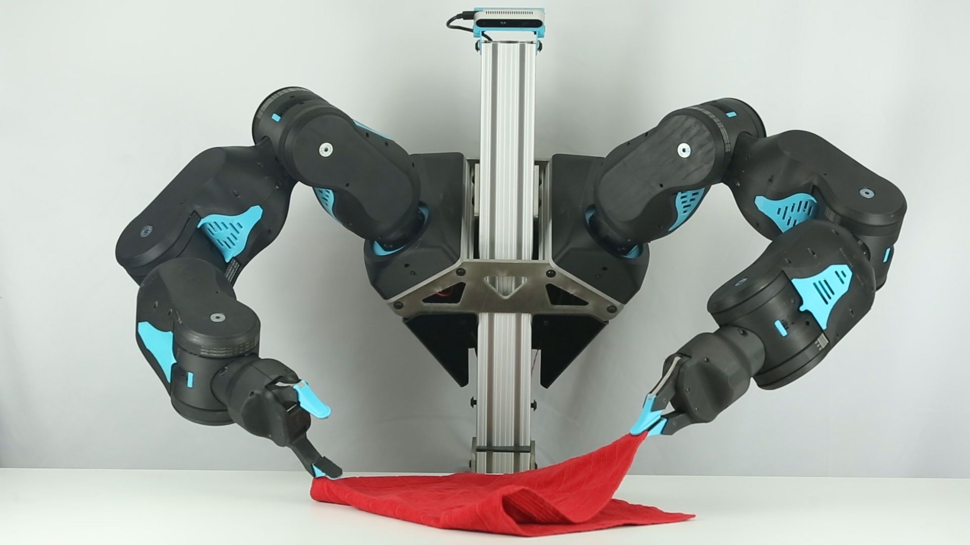 Under teleoperation control, 2-armed version of Blue robot folds a red towel