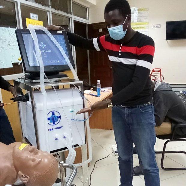 A man demonstrating a ventilator.