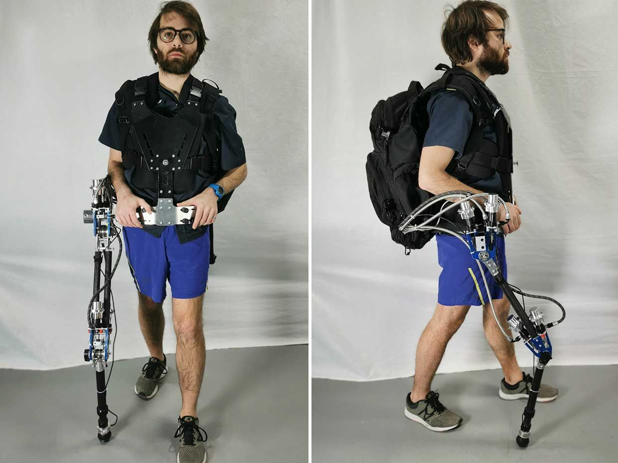 Image of a man demonstrating a robotic limb attached to him.