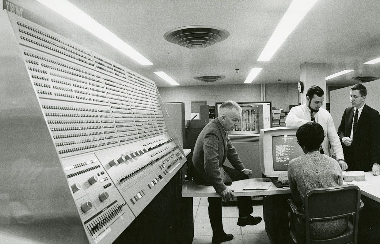 1968. Flanked by a display console with an array of lights and switches, an operator uses a monitor to check the performance of the Model 91. This System/360 installed at NASA's Goddard Space Flight Center in Greenbelt, Md.