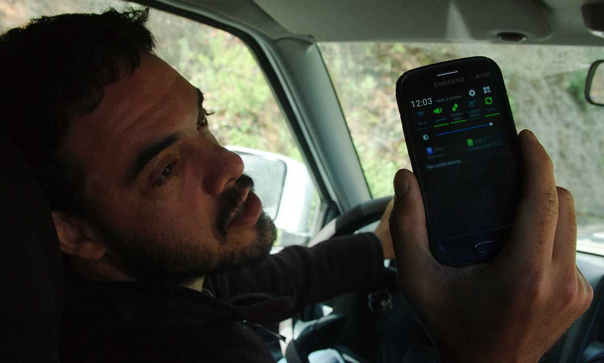 Peter Bloom of Rhizomatica shows off the signal strength on a handset outside of Talea de Castro, Mexico. December 2014.
