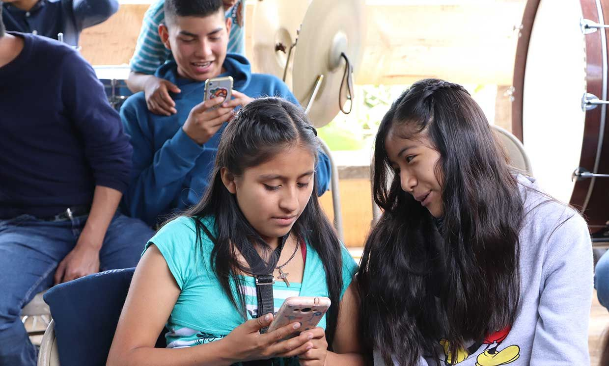 Talean youth on their cell phones