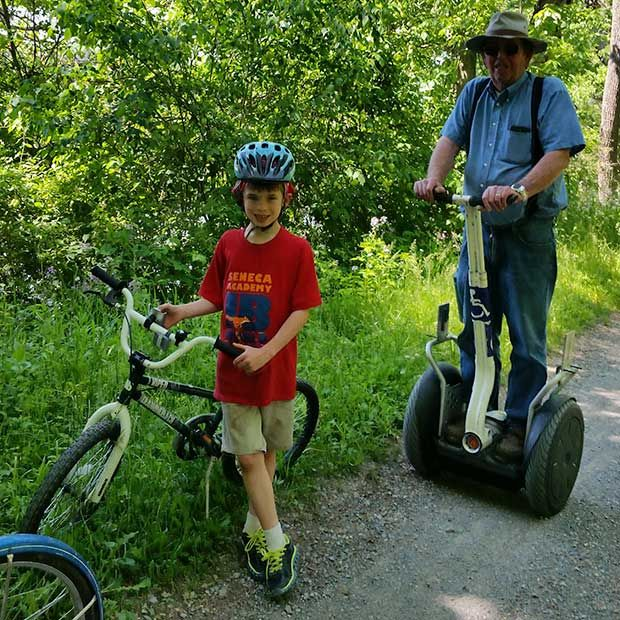 The authors father on his Segway, and her nephew Liam on his bike.
