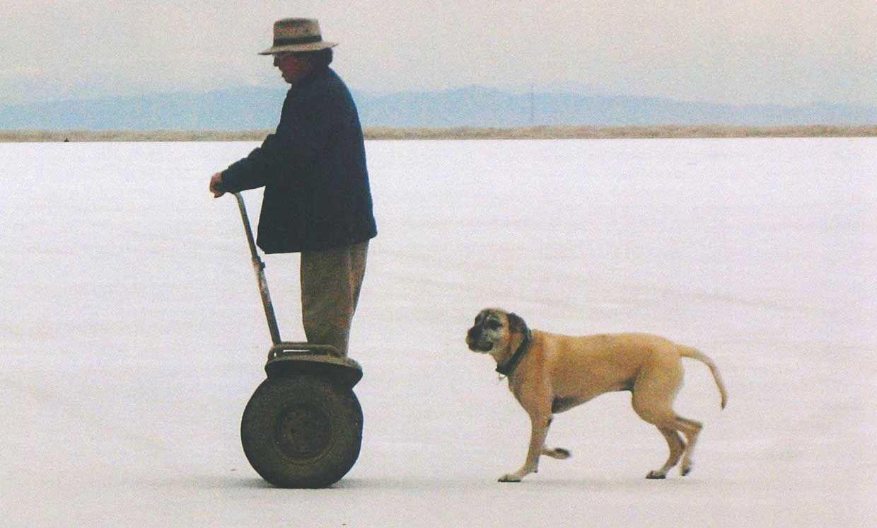 The authors father and dog at the Bonneville Salt Flats