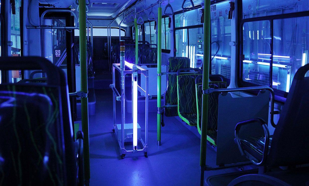 A bus in Shanghai is disinfected with UV light, to help slow the spread of the virus that causes COVID-19.