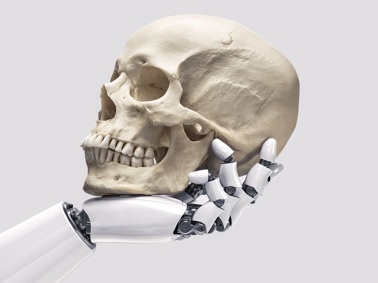 photo illustration of robot hand holding a human skull