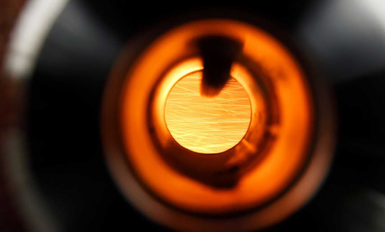 The combustion of the iron powder is visible through the glass in the combustion tube.
