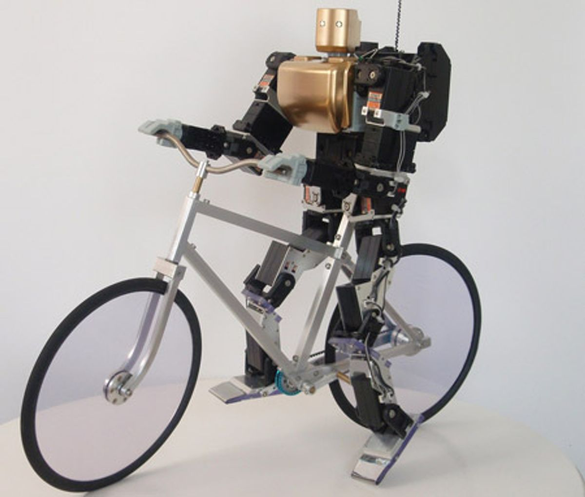 Hobby Robot Rides a Bike the Old-Fashioned Way