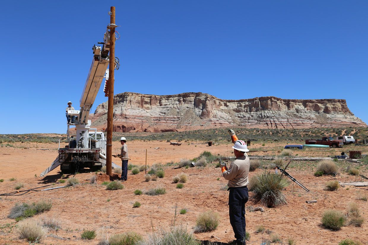 Linemen from Ohio set a pole in the Chinle region of the Navajo Nation.