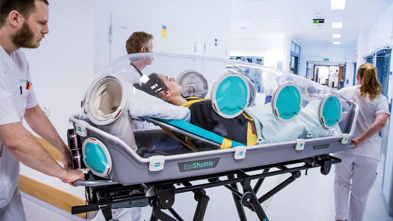 Medical staff pushing a EpiShuttle patient-isolation unit
