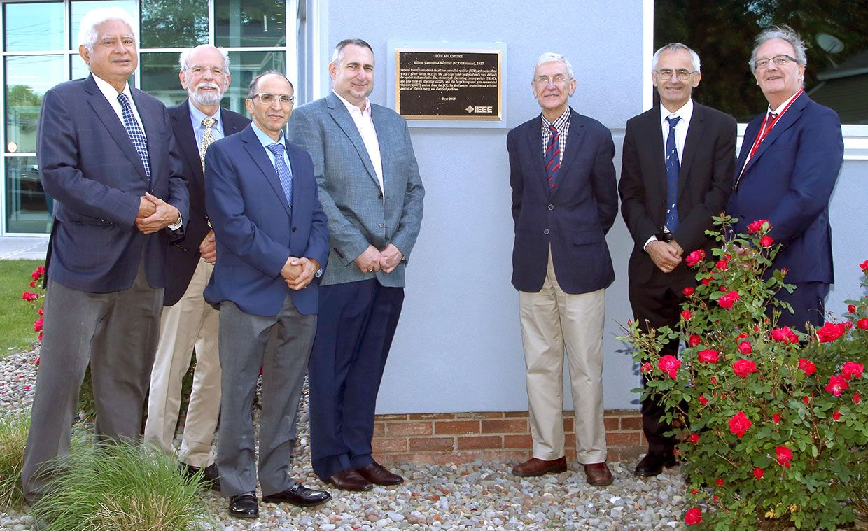 Representatives from the IEEE Power Electronics Society unveil the Milestone plaque for the silicon-controlled rectifier on 14 June 2019. From left: Sreeram Dhurjaty, John Kassakian, Ahmed Elasser, James Mazzarella, José Moura, Frede Blaabjerg, and Gerard Hurley