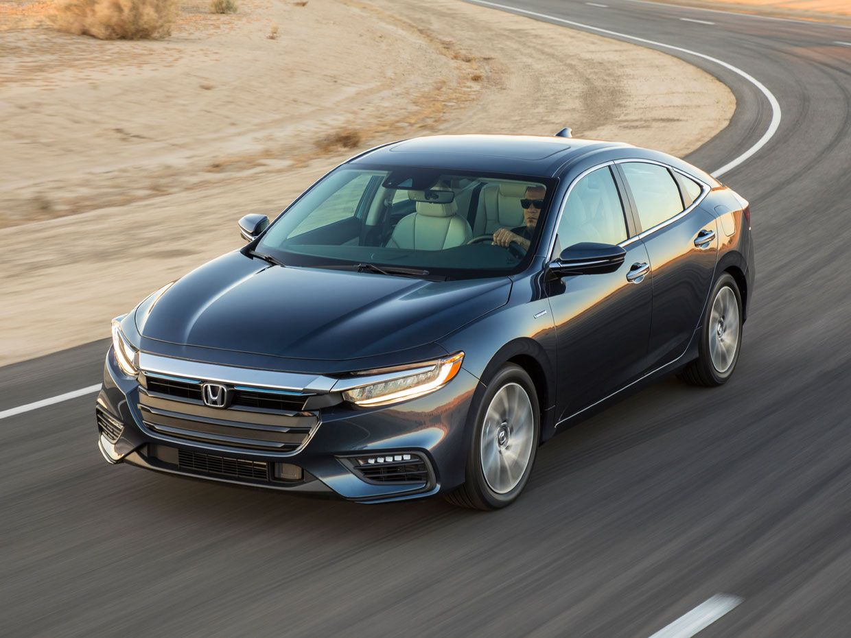 Photo of the Honda Insight driving on a road.
