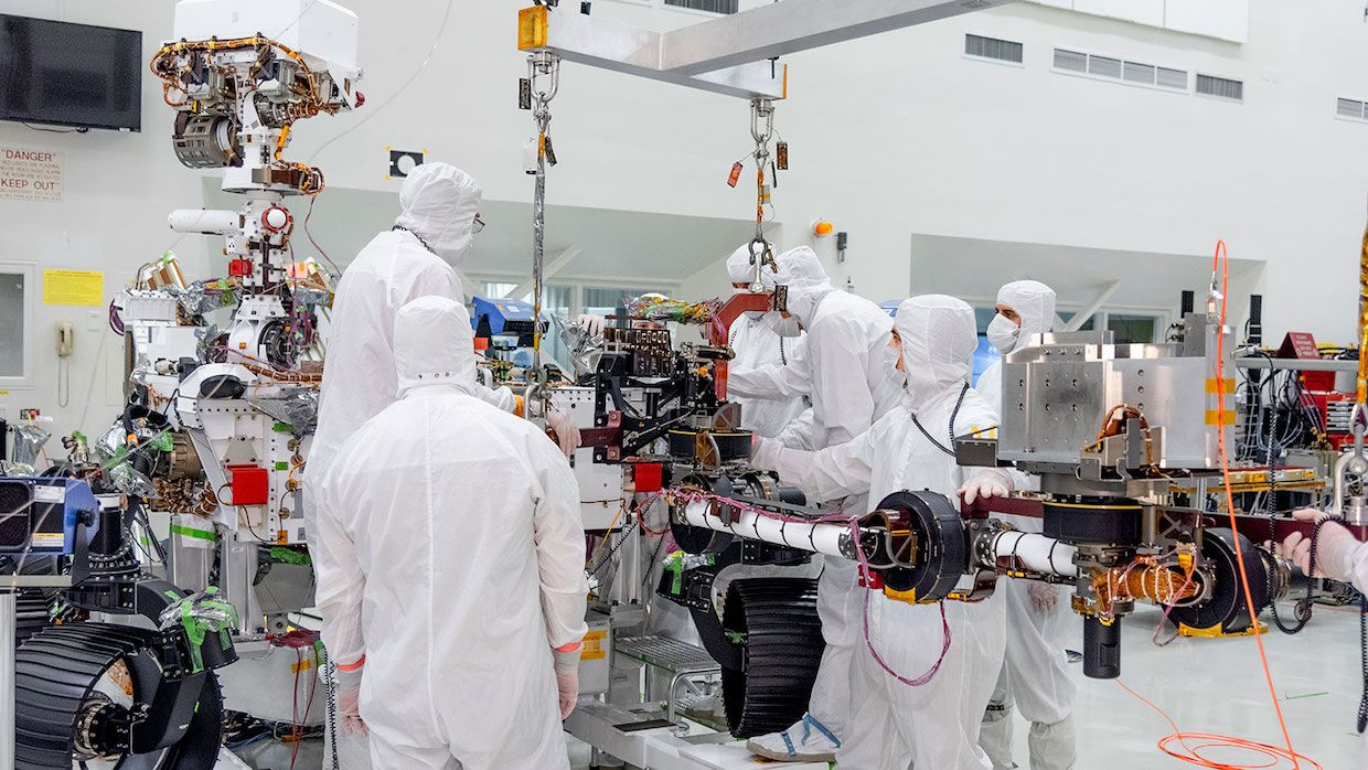 NASA JPL engineers install robot arm on Mars 2020 rover