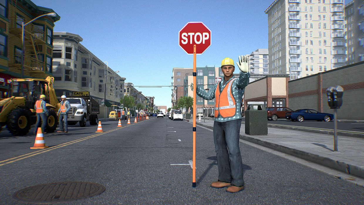 "Image of a construction worker holding a ""stop"" sign."