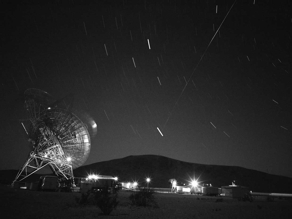Photo of a tracking station and the night sky.