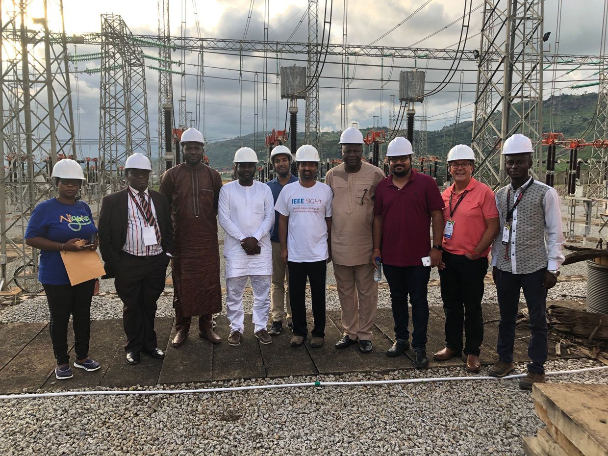 Sampathkumar Veeraraghavan [sixth from left] visiting a power plant in Abuja, Nigeria during the 2019 IEEE Power Africa conference.