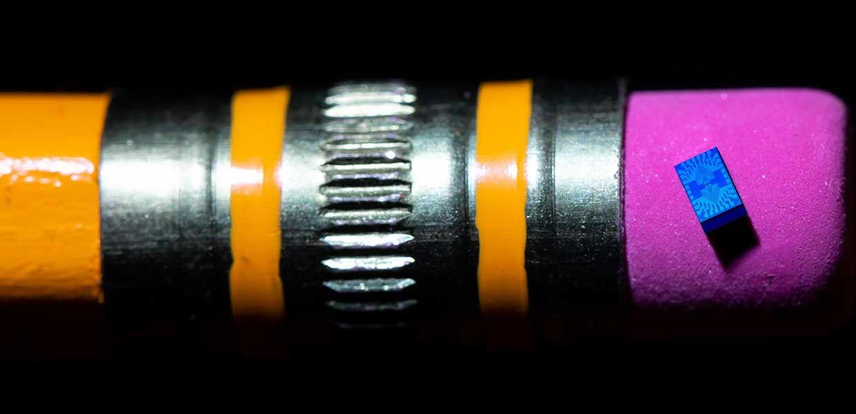 Intel spin qubit chip balanced on a pencil eraser