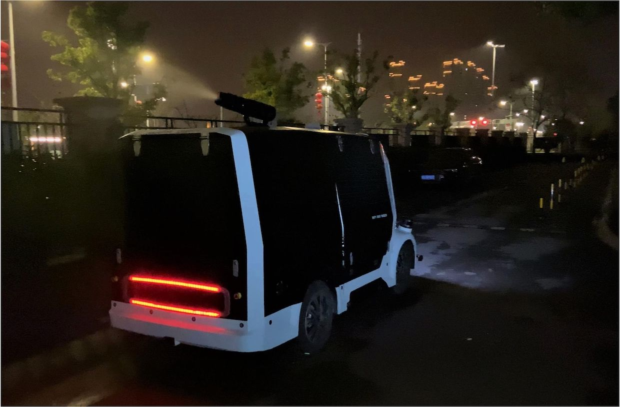Autonomous vehicle developed by Unity Drive Innovation (UDI) sprays disinfectant near a hospital in Shenzhen, China, during the COVID-19 pandemic