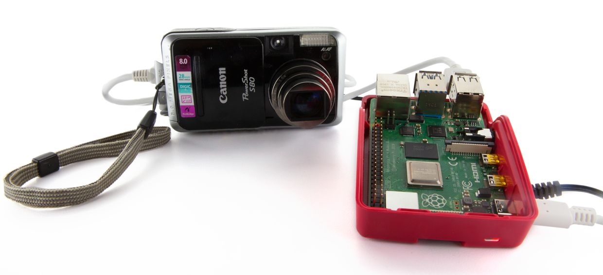 Photo showing a Raspberry Pi and an old digital camera.