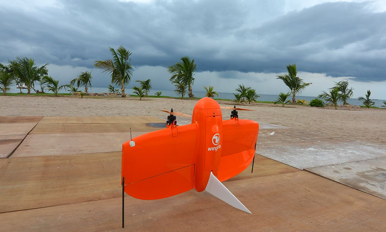 Wingtra's bright orange drone ready to fly in all weather conditions.