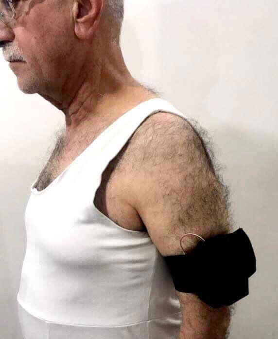 The wearable device on a man's arm