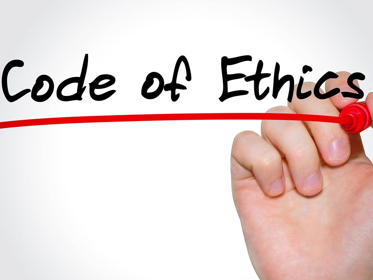 A hand holding a red marker underlines the words Code of Ethics