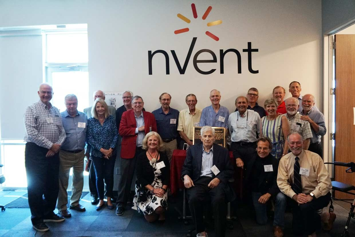 Image of the attendees in front of the nVent logo.