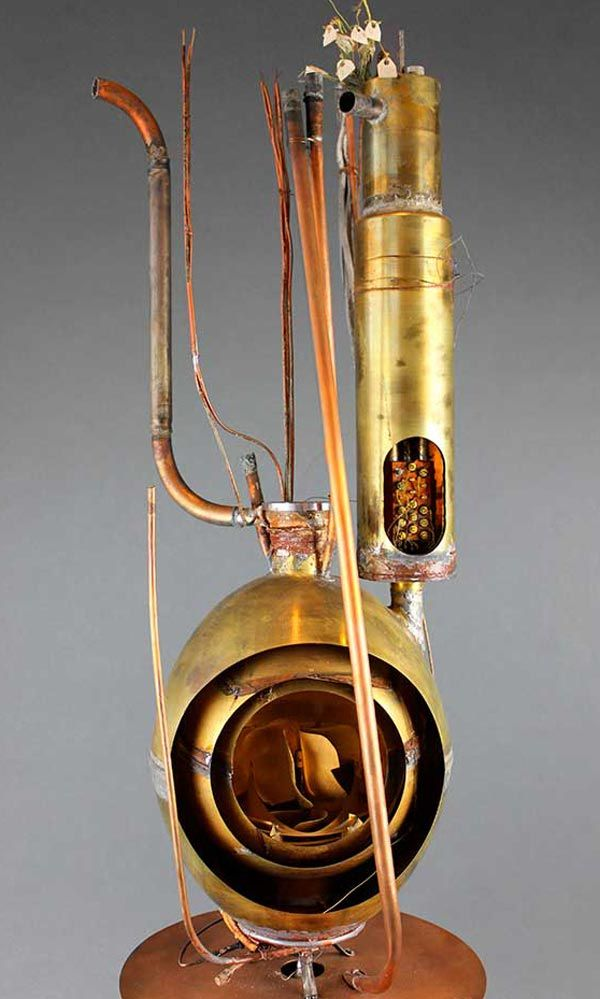 This 1937 steam calorimeter was invented at the U.S. National Bureau of Standards to measure the output of steam power equipment. The front of the instrument has been cut away to show its layers.