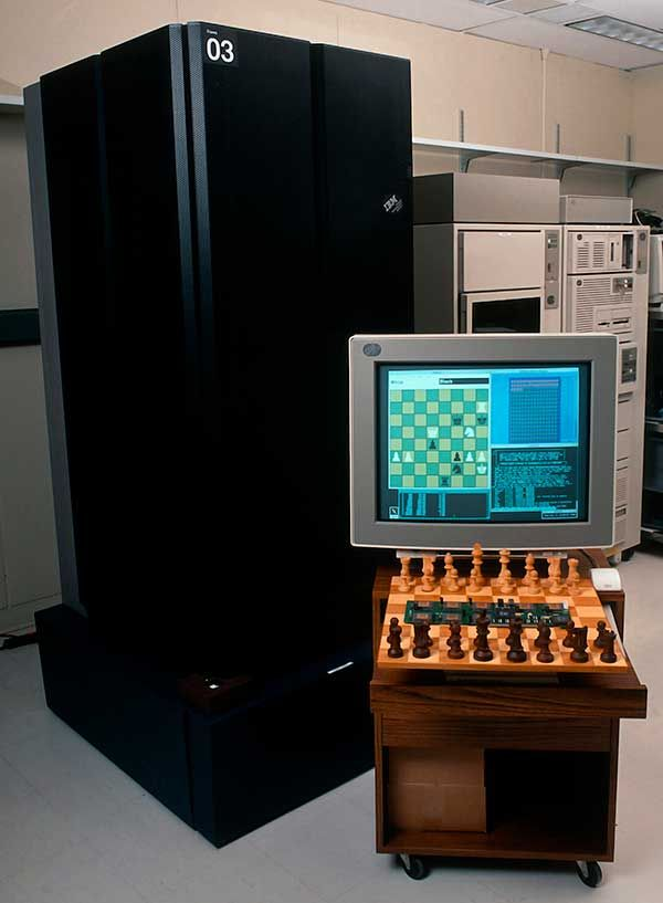 Photo of Deep Blue, an older PC and a chessboard.