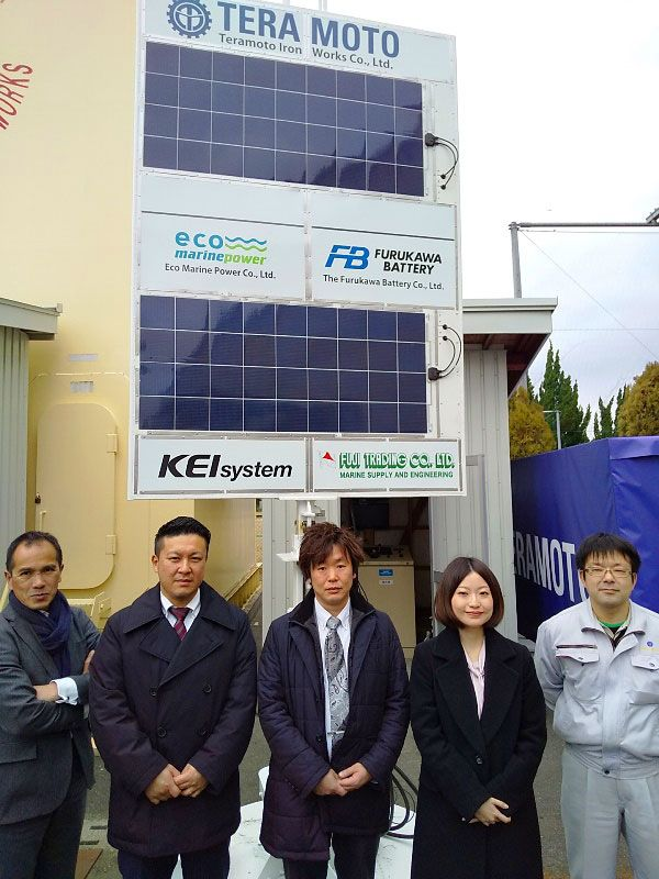 Eco Marine Power partners pose in front of the EnergySail demonstration and test unit at the Onomichi Marine Tech Test Center in Hiroshima Prefecture, Japan, in February 2020.