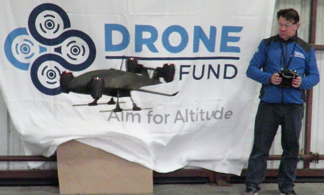 Photograph showing a scale model of the drone being tested by an operator