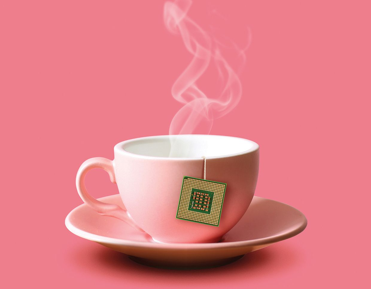 A cup of tea with a microchip at the end of the teabag string.